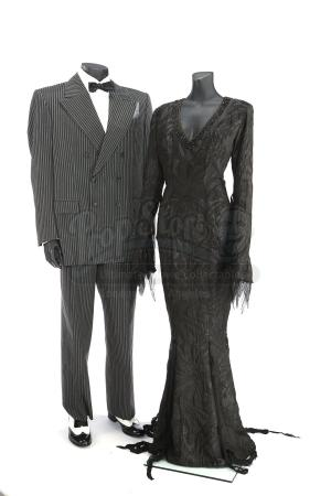 THE ADDAMS FAMILY (1991); ADDAM'S FAMILY VALUES (1993) - Morticia Addams' (Anjelica Huston) and Gomez Addams' (Raul Julia) and Signature Costumes